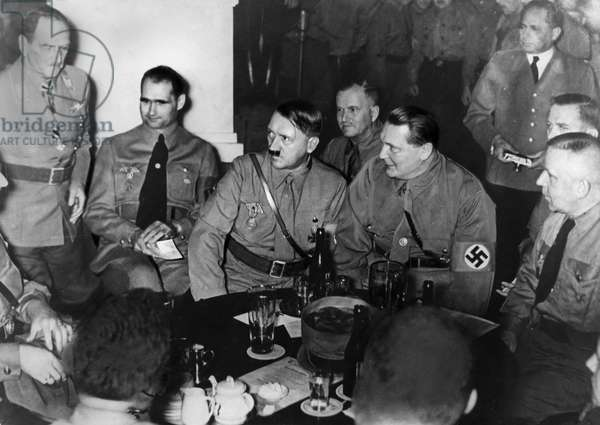 PUTSCH ANNIVERSARY, 1937 Leaders of the Third Reich celebrate the anniversary of the 1923 Beer Hall Putsch at the beer hall in Munich where it was launched. Left to right: Franz Ritter, Rudolf Hess, Adolf Hiter, Hermann Goering, and Max Amann. Photograph, 9 November 1937.