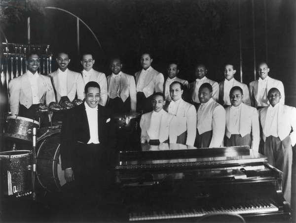 DUKE ELLINGTON (1899-1974) American musician and composer. With his orchestra in 1937.
