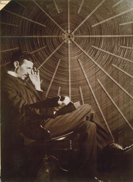 NIKOLA TESLA (1856-1943) American electrician and inventor. Born in Croatia, of Serbian parents. Photographed, c.1895, with one of his electrical generators (oscillators).