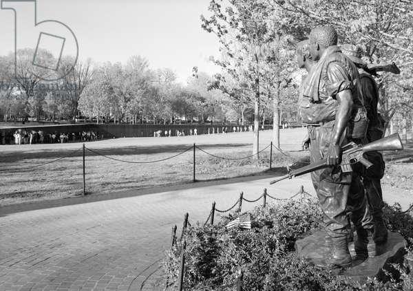 VIETNAM VETERANS MEMORIAL The statue of the Three Soldiers, at the Vietnam Veterans Memorial in West Potomac Park, Washington, D.C. Photograph, 1996.