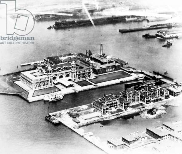 ELLIS ISLAND, c.1920 Aerial view of Ellis Island in New York Harbor. Photograph, c.1920.