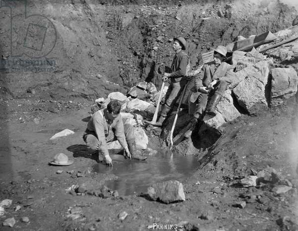 ALASKA: MINING, c.1915 Miners panning for gold in Nome, Alaska. Photograph, c.1915.