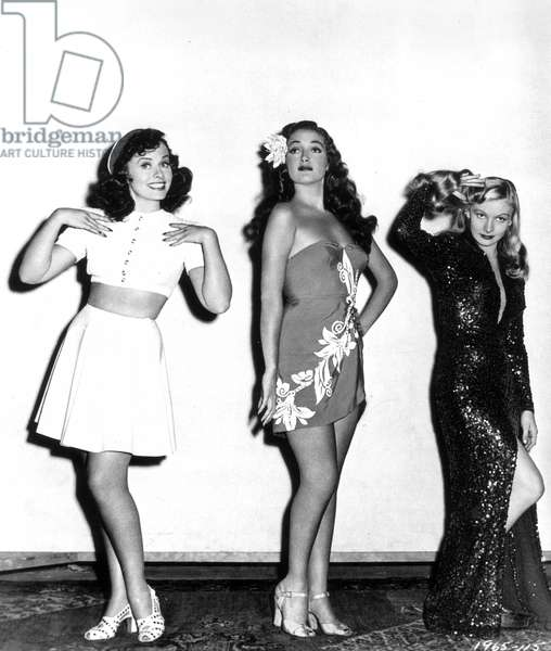 GODDARD, LAMOUR & LAKE Paulette Goddard (1911-1990), Dorothy Lamour (1914-1996), and Veronica Lake (1919-1973) in a publicity still from Paramount's 'Star Spangled Rhythm,' 1942.
