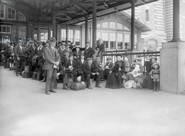 ELLIS ISLAND, c.1910 New immigrant awaiting examination at Ellis Island. Photograph, c.1910.