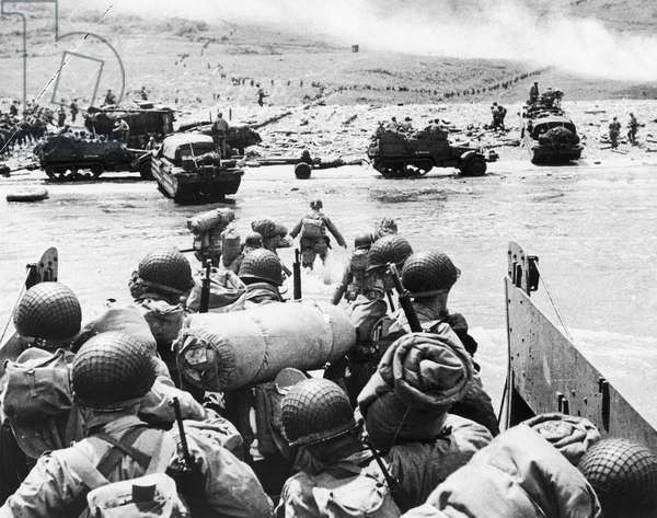 WORLD WAR II: D-DAY, 1944 U.S. Army troops wade ashore to Omaha Beach from a landing craft during the invasion of Normandy, 6 June 1944