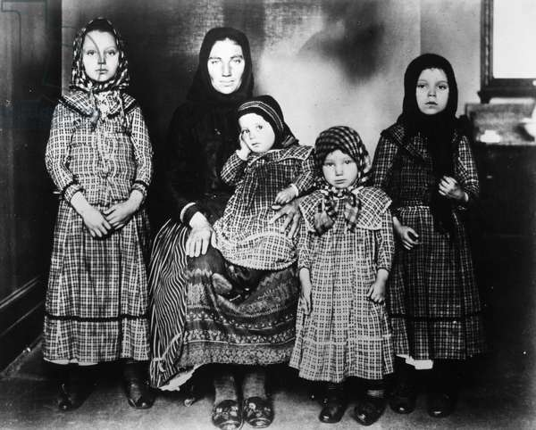 IMMIGRANTS: ELLIS ISLAND An immigrant mother and her children at Ellis Island, c.1900.