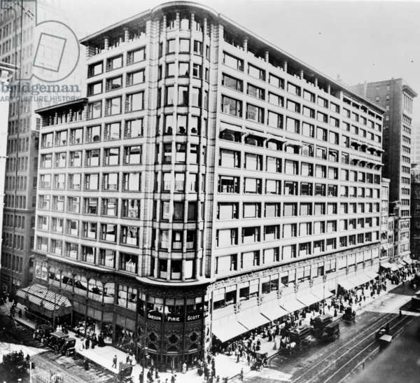 A view of the Carson, Pirie, Scott & Company department store at the corner of Madison Street and State Street in Chicago, Illinois, designed by Louis H. Sullivan, constructed between 1899 and 1904. Photographed c.1910.
