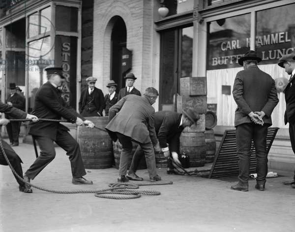 LIQUOR RAID, 1923 Prohibition officers raiding Carl Hammel's restaurant in Washington, D.C. Photograph, 25 April 1923.