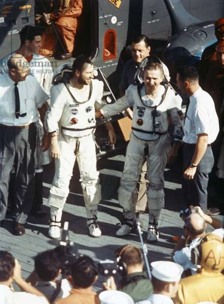 GEMINI 7, 1965 Astronauts James Lovell Jr. and Frank Borman on board the USS Wasp after the Gemini 7 mission. Photograph, 1965.