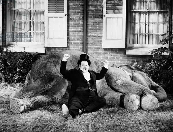 IT'S SPRING AGAIN, 1939 Also known as 'Zenobia.' Oliver Hardy with Zenobia (the elephant). Shot without Stan Laurel after having a falling out with Hal Roach (United Artists).