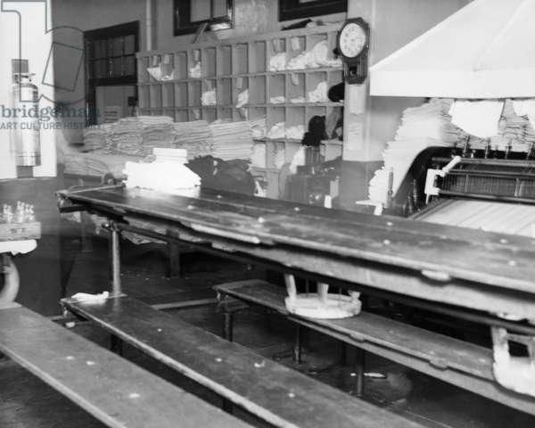 ELLIS ISLAND, c.1940 Laundry sorting and folding facilities at Ellis Island. Photograph, c.1940.