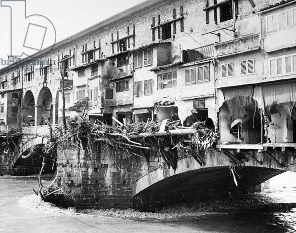 FLORENCE: FLOOD, 1966 Damage to goldsmith shops on the Ponte Vecchio and debris marking the high water line of the flood of the Arno River. Photograph, 5 November 1966.