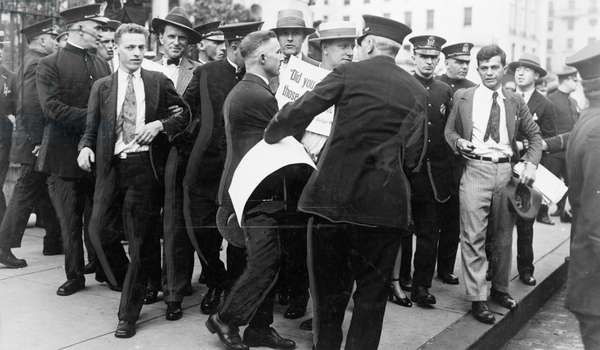 SACCO & VANZETTI, 1927 Riot police guards breaking up a picket line outside of the courthouse in Dedham, Massachusetts, during the trial of Italian anarchists Nicola Sacco and Bartolomeo Vanzetti. Photograph, 1927.