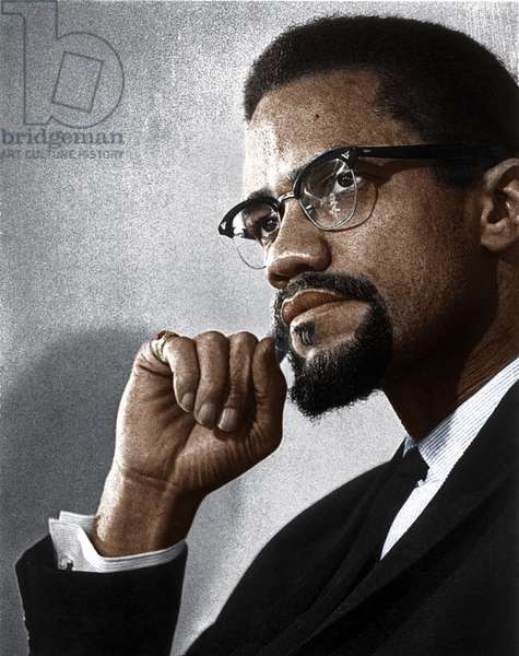 MALCOLM X (1925-1965) Originally Malcolm Little. American religious and political leader. Photograph, c.1963.