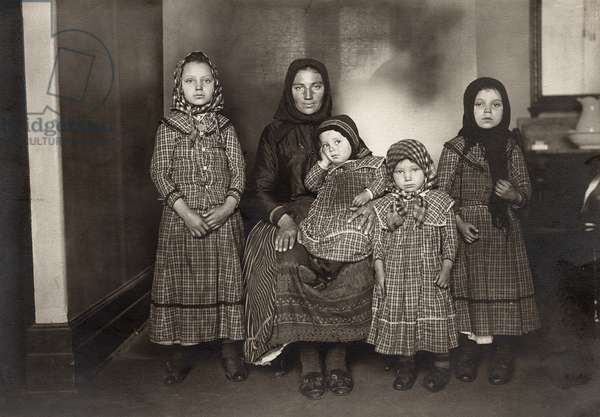 IMMIGRANT FAMILY, c.1900 An immigrant woman and her four children. Photograph by Lewis W. Hine, c.1900.