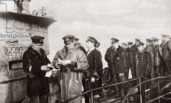 WORLD WAR I: SURRENDER. German Commander surrendering his vessel to a British Naval Officer after signing a statement stating that the vessel was in perfect condition upon surrender. Photograph, c.1918.