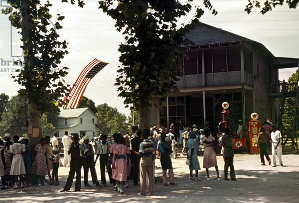 FOURTH OF JULY, 1939 A 4th of July celebration near a Texaco filling station at St. Helena Island, South Carolina, 1939. Photograph by Marion Post Wolcott.