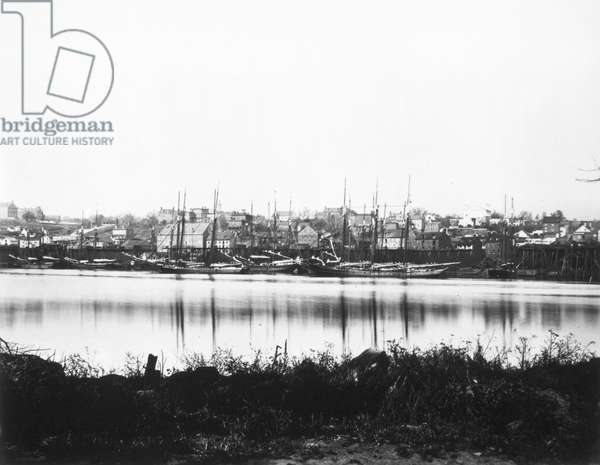 WASHINGTON, D.C., 1865 The waterfront in Georgetown, Washington, D.C., on the Potomac River, viewed from Mason's Island (present-day Theodore Roosevelt Island). Photographed by William Morris Smith, 1865.