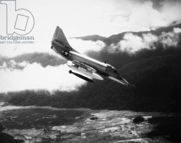VIETNAM WAR: A4 SKYHAWK A U.S. Navy A4 Skyhawk dropping a bomb on Viet Cong forces in South Vietnam, 1965.