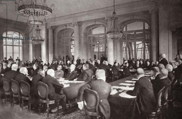 TREATY OF VERSAILLES, 1919 French Premier Clemenceau addressing the German Delegates prior to delivering the peace treaty at the Trianon Palace Hotel, Versailles, France. Photograph, 1919.