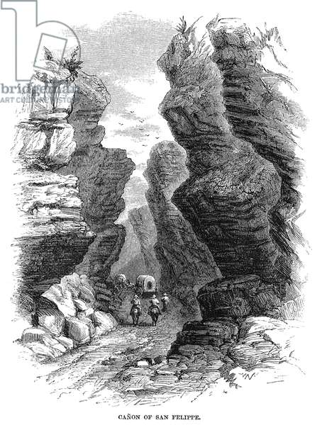 ARIZONA: SAN FELIPE, 1864 Covered wagons travelling through San Felipe Canyon in Arizona. Wood engraving, American, 1864.
