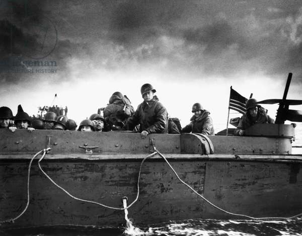 WORLD WAR II: D-DAY, 1944 Soldiers on an American Coast Guard landing barge heading towards a Normandy beach on D-Day, 6 June 1944.