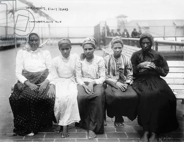 ELLIS ISLAND: IMMIGRANTS Group of women immigrants photographed at Ellis Island, early 20th century.