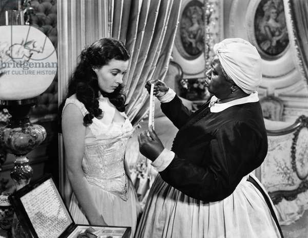 GONE WITH THE WIND, 1939 Vivien Leigh and Hattie McDaniel in a scene from the film.