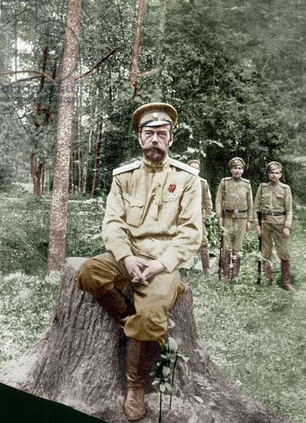 NICHOLAS II (1868-1918) Czar of Russia, 1894-1917. The former czar photographed on the grounds of Tsarskoye Selo Palace while detained there in 1917, with his armed guards standing at right.