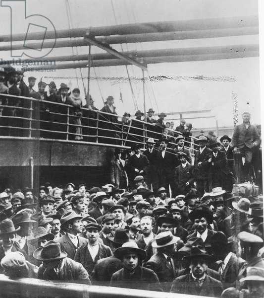 IMMIGRANTS, 1900 Italian immigrants on board ship in New York harbor. Photograph, 1900.