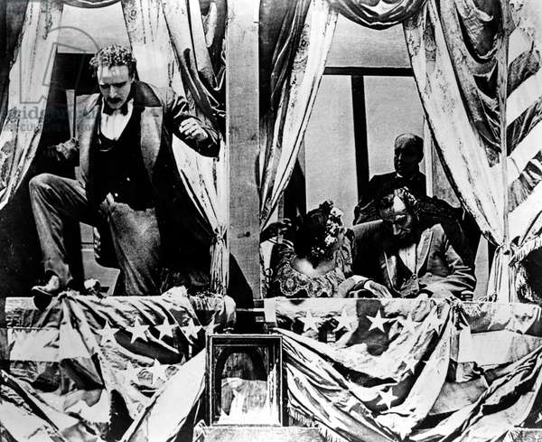 BIRTH OF A NATION, 1915 John Wilkes Booth jumps to the stage after having assassinated President Abraham Lincoln at Ford's Theatre in Washington D. C. Scene from D.W. Griffith's film 'Birth of a Nation,' 1915.