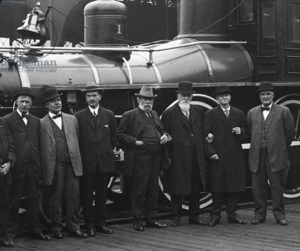 JAMES JEROME HILL (1838-1916). American railway promoter. Photographed (fourth from right) with some of his associates in front of the 'William Crooks,' the first locomotive of the Great Northern Railway Company.
