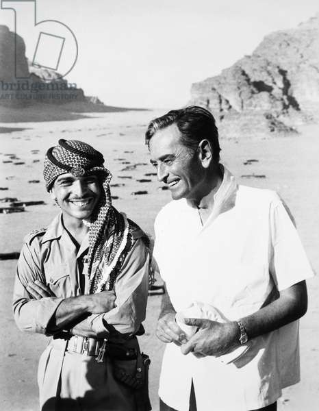 HUSSEIN I (1935-1999) King of Jordan, 1952-1999. With Sir David Lean (1908-1991) during the filming of Lean's film 'Lawrence of Arabia,' 1962.