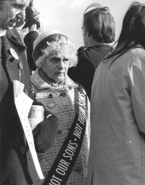 ANTI-WAR PROTEST, 1969 A woman wearing a sash saying 'Not our sons, not their sons' joins a 600,000-strong demonstration in Washington, D.C., on 15 November 1969, to protest the war in Vietnam.