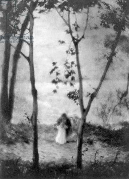 MARY LEARNS TO WALK A woman teaching a little girl to walk with trees in foreground in the spirit of the French Impressionists. Photogravure after a photograph by Edward Steichen, 1913.