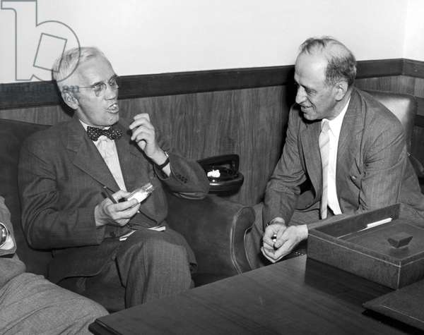 SIR ALEXANDER FLEMING (1881-1955). Scottish bacteriologist. Fleming (left) taking some of the new Wyeth penicillin tablets as Alfred Barol of the Wyeth Institute looks on.