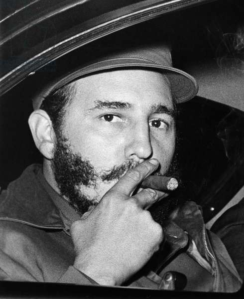FIDEL CASTRO (1926- ) Cuban revolutionary leader and head of state. Castro smoking a cigar on his way to give a speech at Princeton University in New Jersey, 1959.