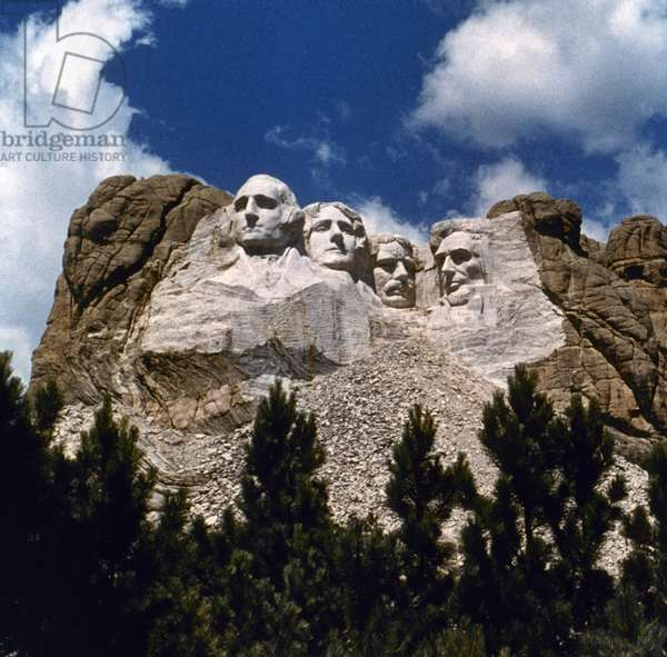 MOUNT RUSHMORE Mount Rushmore National Memorial in South Dakota, created by sculptor Gutzon Borglum between 1927 and 1941. From left: Presidents George Washington, Thomas Jefferson, Theodore Roosevelt and Abraham Lincoln. Photograph, c.1962.