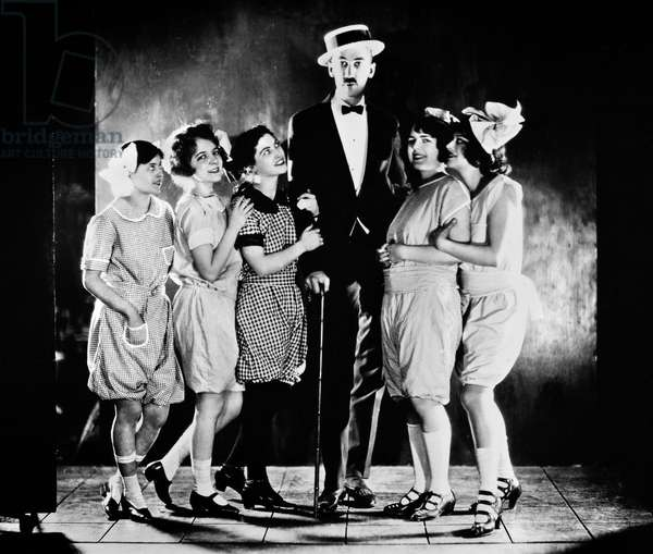 ROBERT SHERWOOD (1896-1955) American playwright. Photographed by James Abbe, with the cast of a play. Left to right: Constance Binney, Helen Hayes, June Walker, Sherwood, Margalo Gillmore and Lenore Ulric.