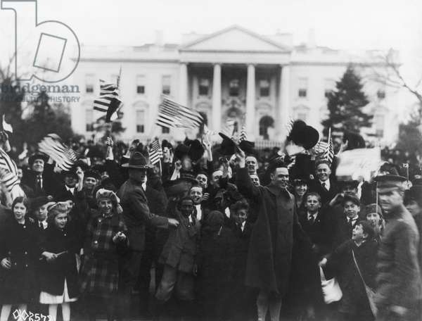 D.C.: ARMISTICE, 1918 A crowd celebrating the victory and armistice at the end of World War I, outside the White House in Washington, D.C., 1918.