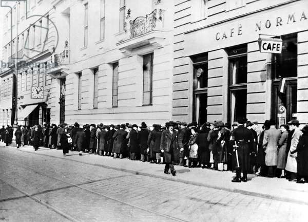 AUSTRIA: JEWS, 1938 Jews in Vienna standing in line to be registered after the Anschluss, Nazi Germany's annexation of Austria in March 1938.