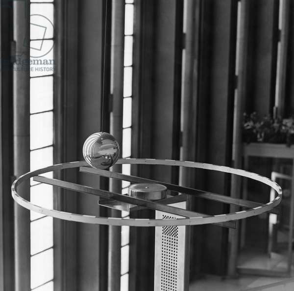 UNITED NATIONS, 1969 The Foucault pendulum in the lobby of the United Nations General Assembly building in New York. Photograph, 1969.