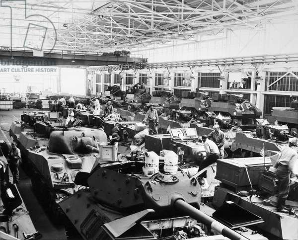 WWII: MUNITIONS PLANT, 1943 Men and women working on tanks at the Ford Motor Company plant in Richmond, California. Photograph, 1943.