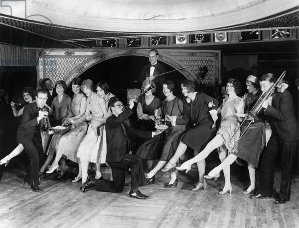 DANCE: CHARLESTON, c.1926 Contestants at a Charleston dance contest being served food by musicians at a nightclub in New York City, c.1926.