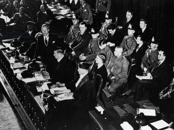 REICHSTAG FIRE TRIAL, 1933 View of the dock with defendants and defense counsel, during the Reichstag fire trial in Leipzig, Germany. Photograph, 1933.