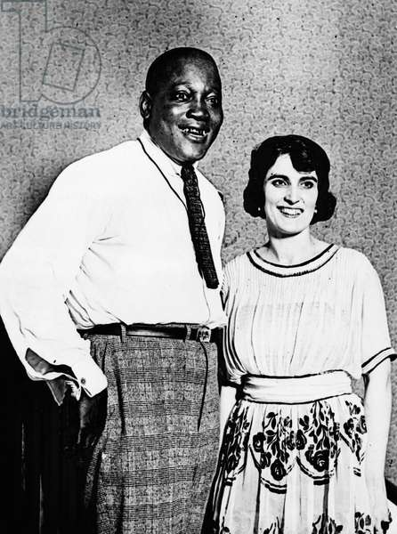 JACK JOHNSON (1878-1946) American heavyweight pugilist. Johnson photographed with his wife Lucille Cameron in 1921.