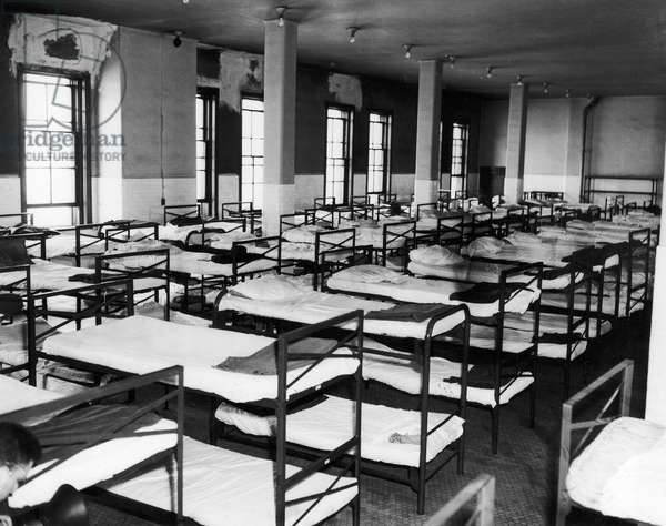ELLIS ISLAND: DORMITORY Night quarters for male detainees at the immigration station in New York Harbor, 1947. Detainees were not allowed in the dormitory during daylight hours.