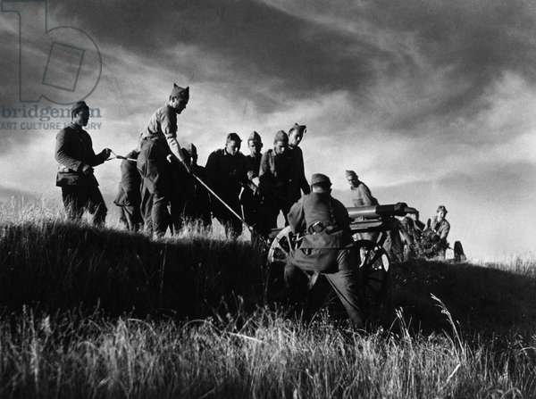SPANISH CIVIL WAR, c.1937 Soldiers hoisting a cannon onto a hill during the Spanish Civil War. Photograph by James Abbe, c.1937.