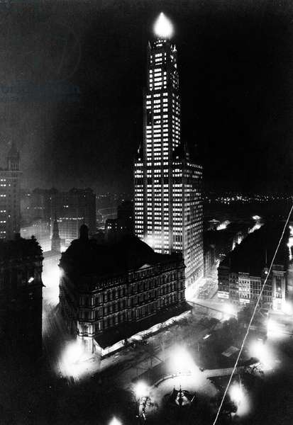 WOOLWORTH BUILDING, 1913 The Woolworth Building, New York City, the world's tallest building at the time of its completion in 1913 until 1930. Photographed at night, c.1913.