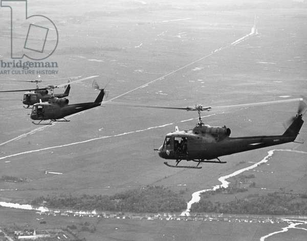 VIETNAM WAR: HELICOPTERS American UH-1B helicopters in flight over South Vietnam, mid-1960s.